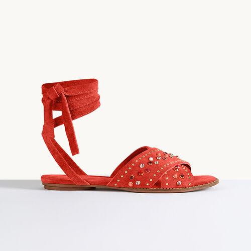 Flache Sandalen mit Nieten - Schuhe - MAJE