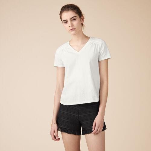 T-Shirt aus Baumwolle mit Details - Tops - MAJE